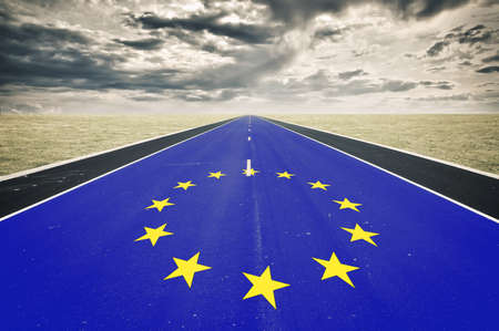 European flag, road perspective, dark clouds, crisis concept