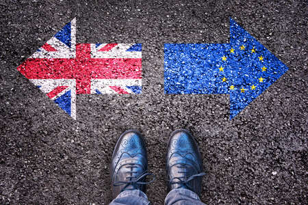 jack tar: Brexit, flags of the United Kingdom and the European Union on asphalt road with legs