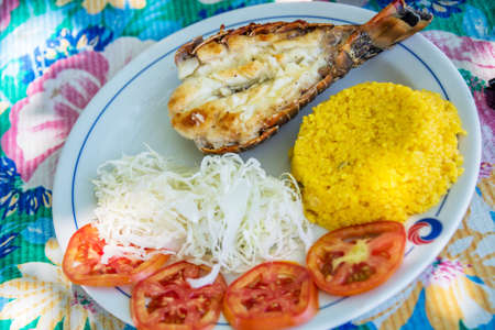 langouste: Grilled lobster with rice and salad on a beach restaurant in Cuba Stock Photo