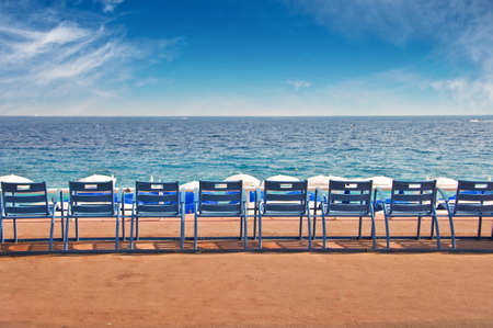 Line of empty chairs on the English Promenade in the city of Nice, France