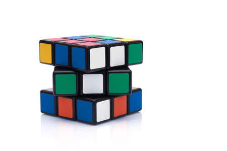 rubik: PARIS FRANCE - SEPTEMBER 29, 2015: Rubiks cube on the white background. This famous game was invented by a Hungarian architect Erno Rubik in 1974.