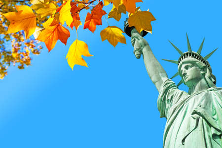 Statue of Liberty and autumnal leaves, New York, Stock Photo