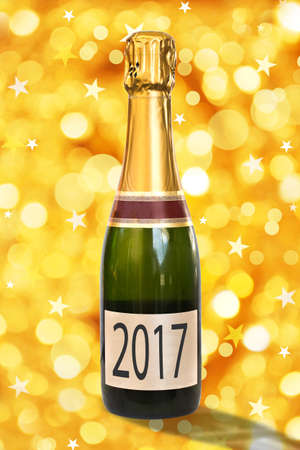 french: 2017 on a label of a bottle of Champagne, shiny golden background, 2017 new year concept Stock Photo