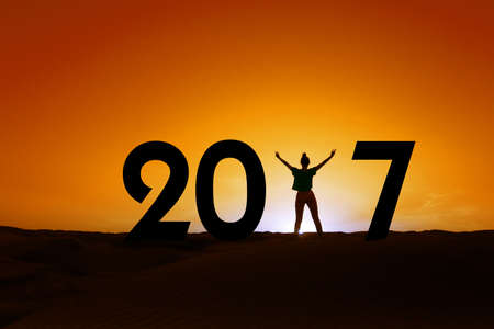 celebrate year: 2017, silhouette of a woman standing in the sunset, 2017 new year concept