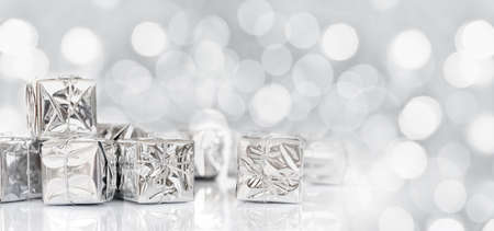 shiny: Small Christmas gifts in shiny paper, panoramic christmas silver background