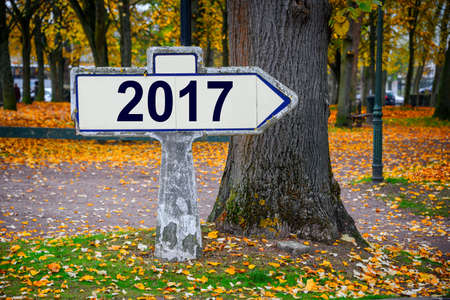 2017 written on an old french roadsign, fall background