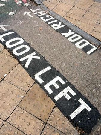 prudent: Look left, written on the street in London UK