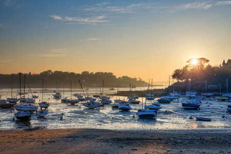 st malo: Sailboats at low tide and sunset on the beach of St Briac near St Malo, Brittany, France