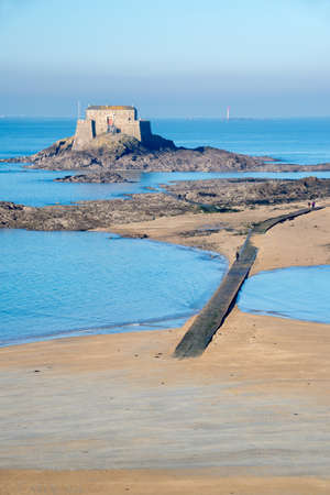 petit: Petit Be island at low tide in Saint Malo, Brittany, France Stock Photo