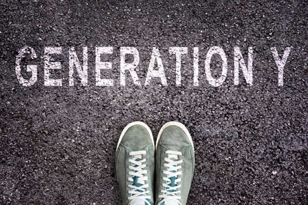 generation y: Text Generation Y written on asphalt with shoes