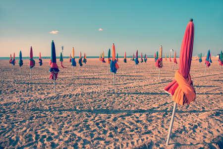 Colorful parasols on Deauville beach, France, vintage process Stok Fotoğraf