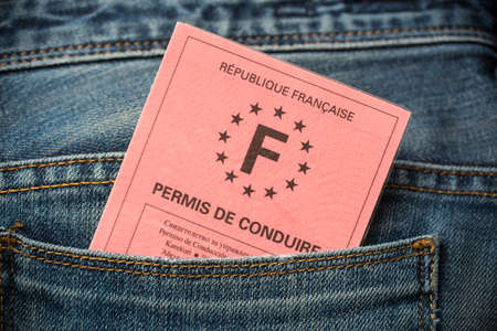 French driving license in the rear pocket of blue jeans, driving licence test concept Foto de archivo