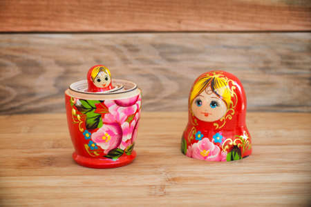 Matryoshkas, russian nesting dolls on wood background, mother, daughter and family women concept Stock Photo