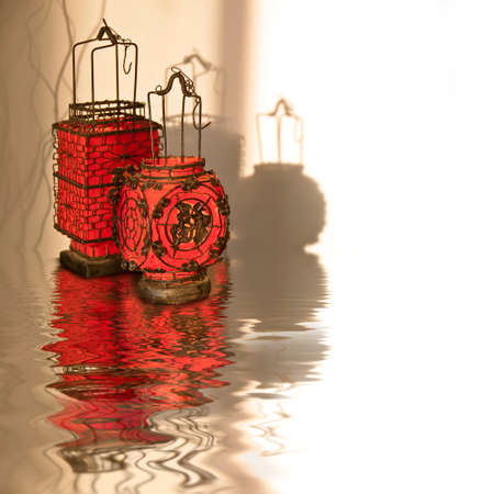 reflection: Red chinese lanterns, water reflections