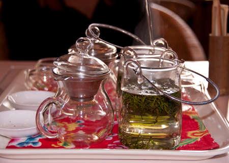 white yummy: Tea in a glass teapot Stock Photo