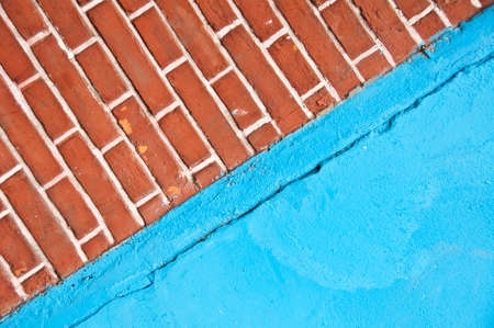 Blue wall with red bricks texture background
