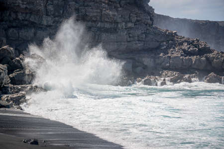 Huge wave crashing on the rocks on Playa del Paso, a black sand beach in Lanzarote, Canary Islands, Spain Stock Photo