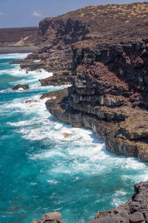 View of the ocean and cliffs on Timanfaya coastal route, a path in the national park of  Lanzarote, Canary Islands, Spain