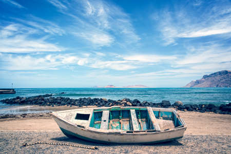 ocean fishing: Old colorful fishing boat, atlantic ocean in the background, Lanzarote, Canary islands, Spain