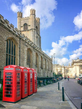 cambridgeshire: Old style British telephone booths by Great Saint Mary church in the University city of Cambridge, UK