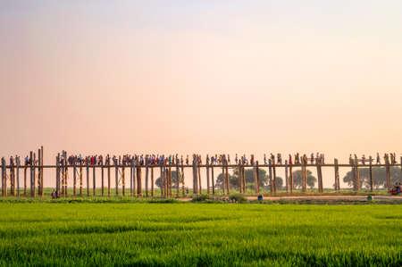 People on U Bein bridge over the Taungthaman Lake in Amarapura, Mandalay, Myanmar Stock Photo