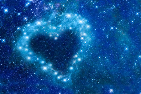 Bright stars in a night sky arranged in the heart of a romantic magic night, love and Valentines day card - Part of this image is furnished by NASA Stock Photo