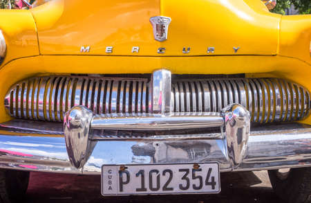 HAVANA, CUBA - APRIL 18: Front of a yellow classic american Ford Mercury car, on April 18, 2016 in Havana