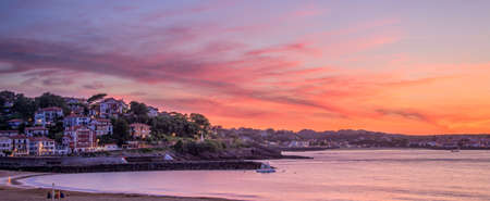 basque country: Panorama of Saint Jean de Luz beach at sunset, France