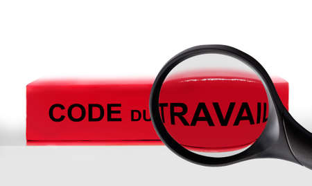 French labor code book and magnifying glass, labor code law reform in France concept