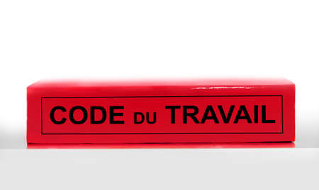 French labor code book on white background, labor code law reform in France concept