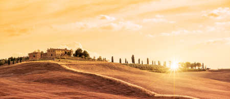 Beautiful typical panorama landscape of Tuscany at sunset, Italy 스톡 콘텐츠