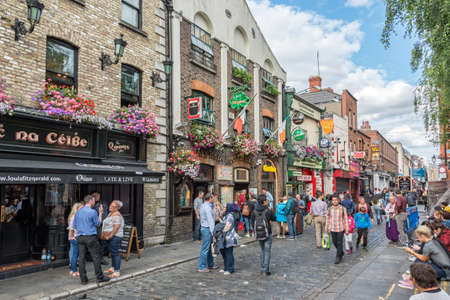 DUBLIN, IRELAND - AUGUST 12: Busy street in the touristic Temple Bar area, in Dublin, Ireland Editorial
