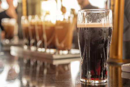 Close up of a glass of stout beer in a bar