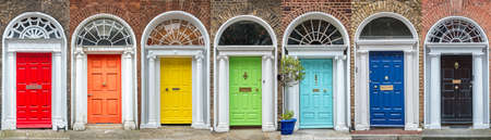 Panoramic rainbow colors collection of doors in Dublin, Ireland 免版税图像
