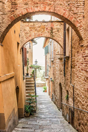 Beautiful narrow street in Montepulciano in Tuscany Italy. Montpulciano is famous for its wine. Stock Photo
