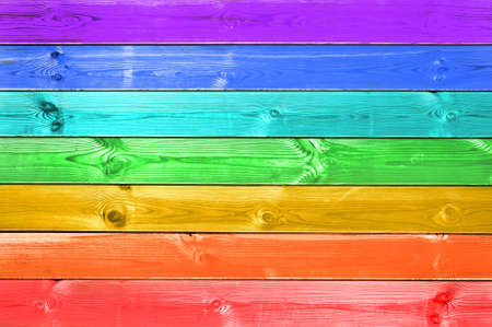 Pastel colorful rainbow painted wood planks background, gay flag concept