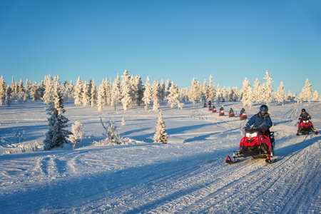 Group of snowmobiles in Lapland, near Saariselka, Finland 免版税图像