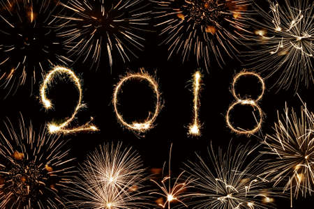 2018 written with sparkles and fireworks Archivio Fotografico