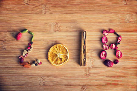2018 written with spices on wooden background Archivio Fotografico