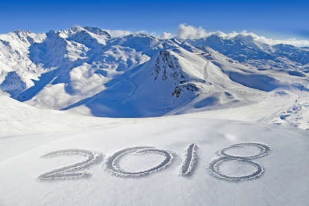 2018 written in the snow, mountain landscape in the background