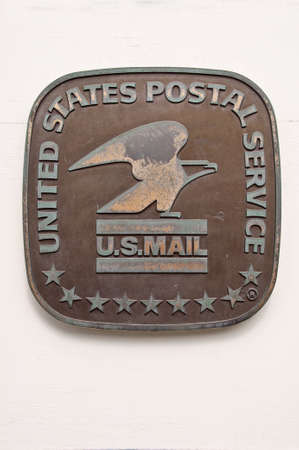 PARK CITY, UTAH - AUGUST 08: United states postal service (USPS) metallic sign on a wall, in Park City, on August 8, 2012