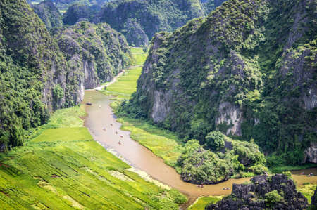 Aerial view of the river among rice fields and limestone mountains, vietnamese scenic landscape at ninh Binh, Vietnam Stock Photo
