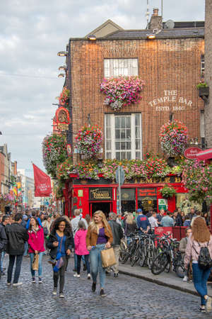 DUBLIN, IRELAND - AUGUST 12: People in the street in front of the famous Temple Bar, in Dublin, Ireland