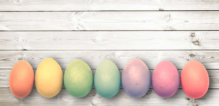 Pastel colored eggs on  white wooden planks, panoramic easter background Stock Photo