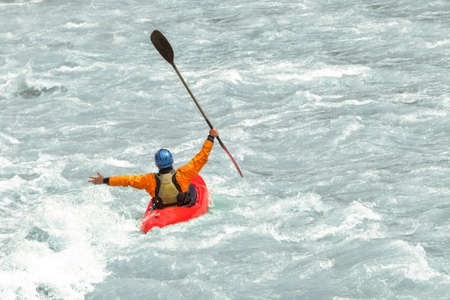 Kayaker having fun in white water rapids,  with copy space Stock Photo