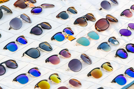 Display of colorful sunglasses for sale in a street