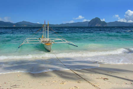 Traditional fishing boat on the beach at Entalula island in El Nido, Palawan Philippines