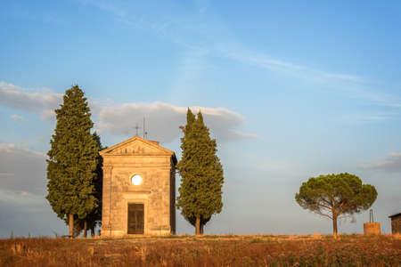 Vitaleta Chapel, Tuscan landscape near San Quirico dOrcia, Siena, Tuscany, Italy Stock Photo