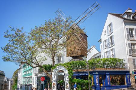 Moulin de la Galette, famous restaurant and old wooden windmill in Montmartre, Paris France Editorial