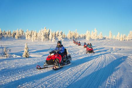 Group of snowmobiles in Lapland, near Saariselka, Finland Editorial